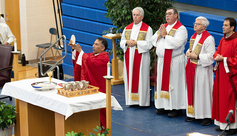 Fr Storey celebrates Mass at Detroit Catholic Central