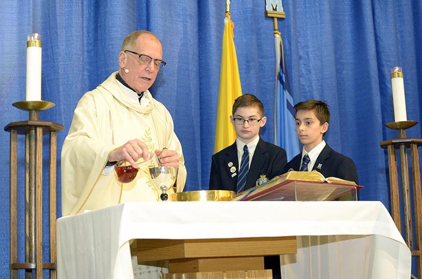 Father May Prepares Holy Communion at St. Michael's College School