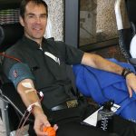 Father Patrick Fulton giving blood