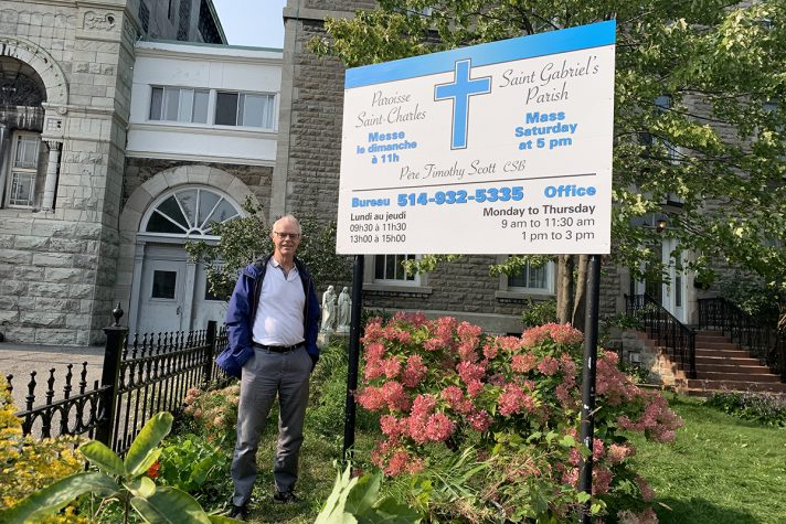 Father Scott, CSB in front of Église St-Charles in Montreal, Quebec where he celebrates Mass for two communities.
