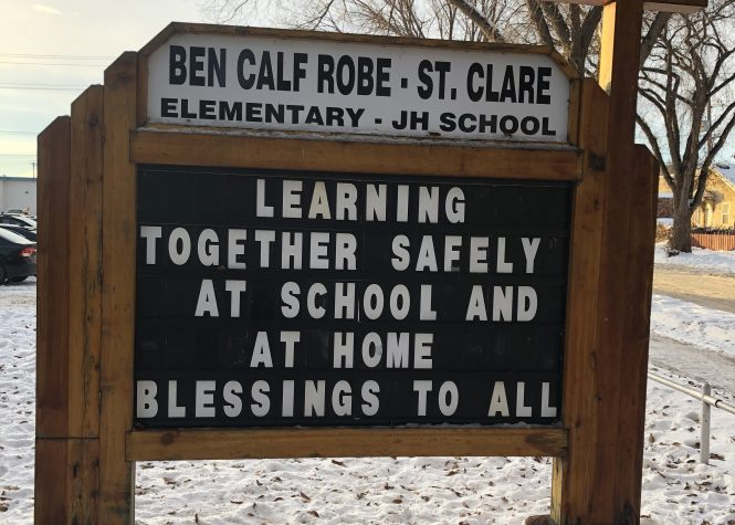 Sign in front of Ben Calf School reads Learning Together Safely at School and at Home, Blessings to All