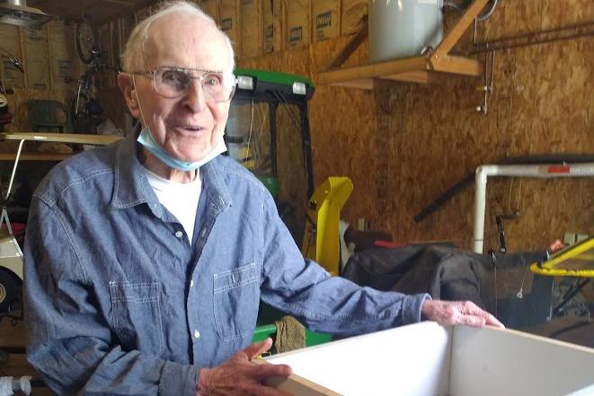 Fr. Tom Dugan assembles bee hives
