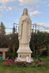 statue of the Little Flower at Mission Hill Celemetery